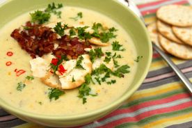 Shrimp and sweet corn chowder topped with crumbled bacon, crushed crackers, parsley and Thai chile