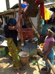 Girls making rice flour